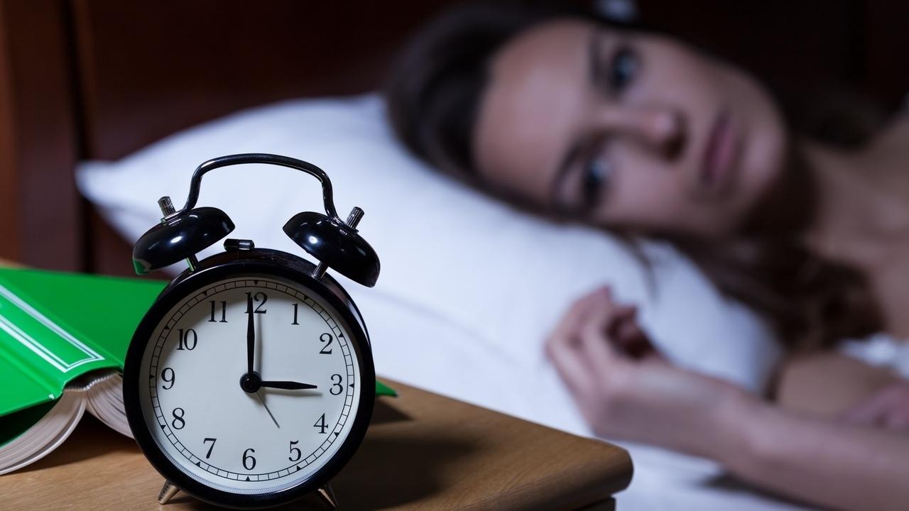 image of a woman unable to sleep
